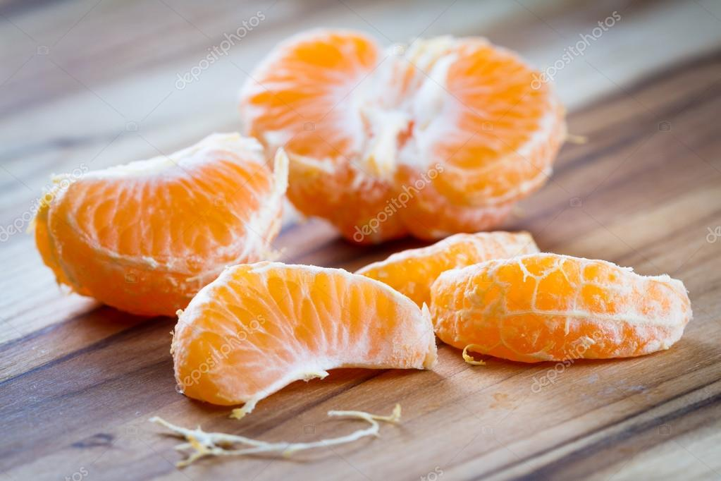 peeled orange on a cutting board