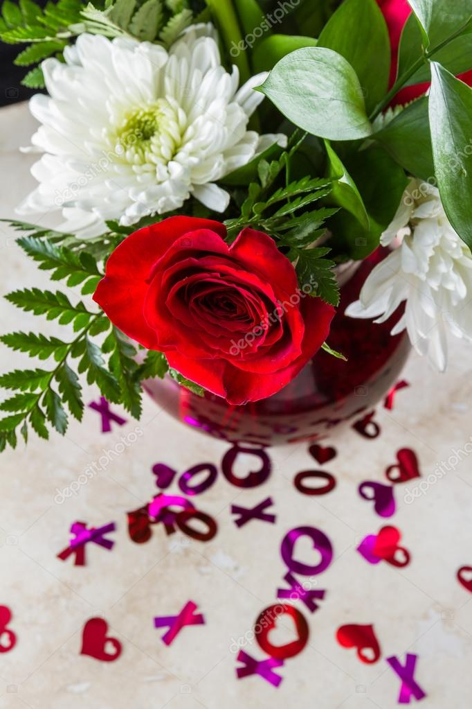 xoxo hugs and kisses with a red rose stock photo wollertz 99849428