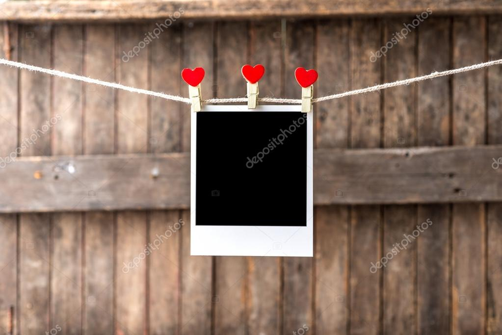 Old picture frame hanging on the clothesline — Stock Photo © 9george ...