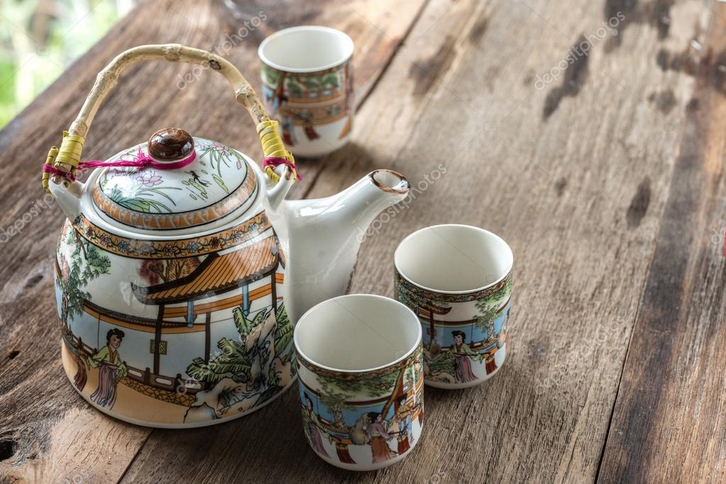 Antique Chinese tea set on wooden table Selective focus u2014 Photo by 9george & Antique Chinese tea set on wooden table u2014 Stock Photo © 9george ...