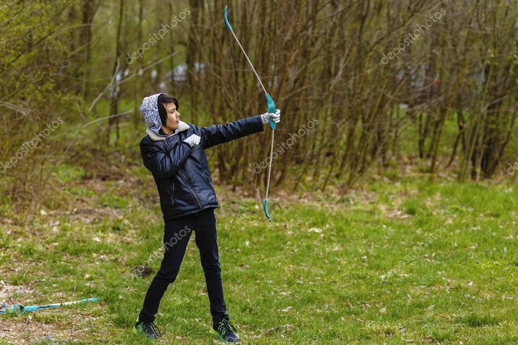 6e566b93bf6c Boy archer shooting with his bow at an outdoor archery range– stock image