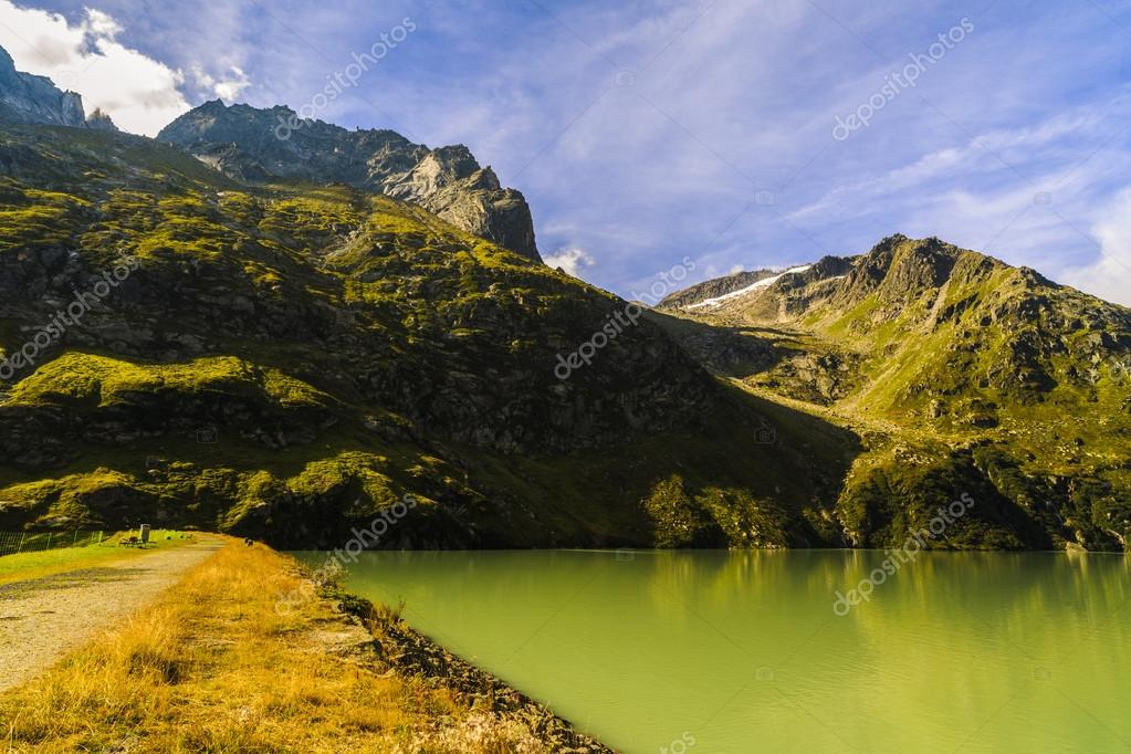 Фотообои Idyllic summer landscape with clear mountain lake in the Alps
