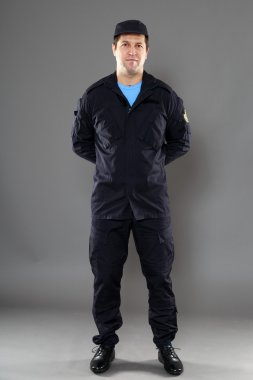 Security guard full body  isolated on gray background