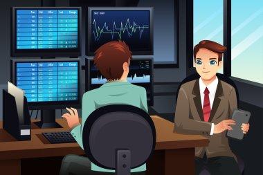 Stock trader looking at the stock market monitors