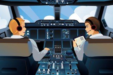 Pilot and copilot inside the cockpit