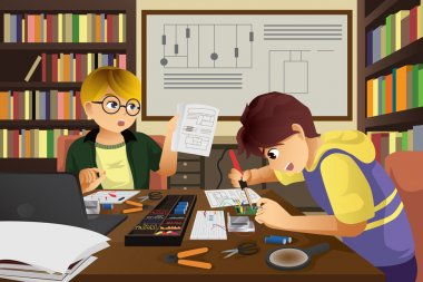 Two kids working on an electronic project