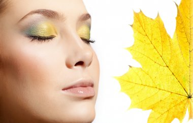 Closeup portrait of attractive  caucasian  woman  isolated on white studio shot lips  face closeup makeup  head eyes closed skin yellow maple leaf autumn stock vector