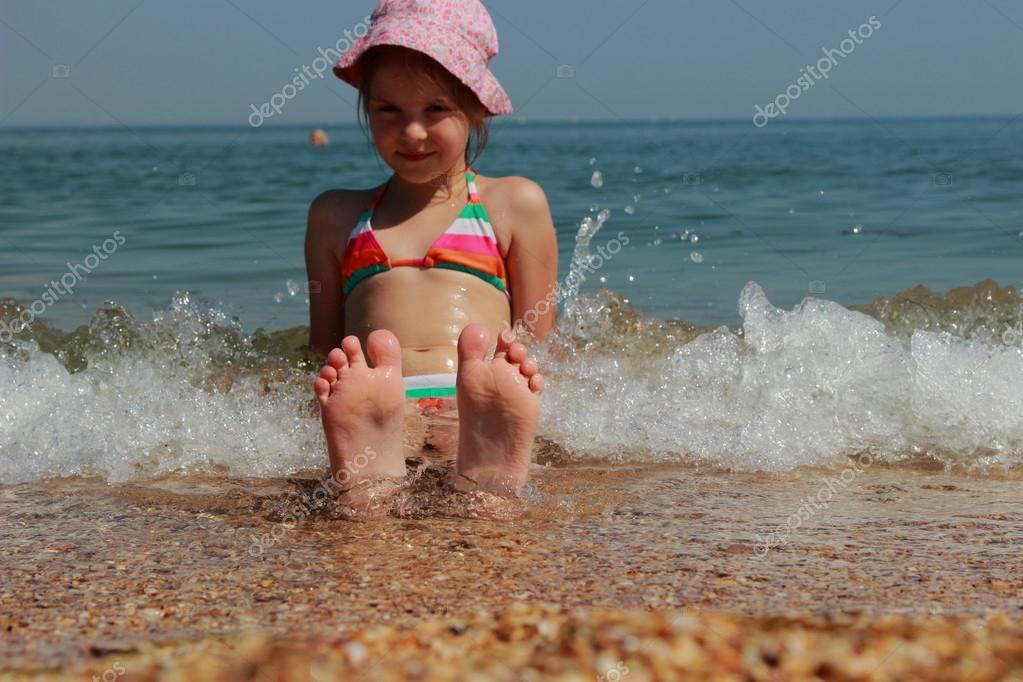Kids Feet In The Black Sea Stock Photo 52681519