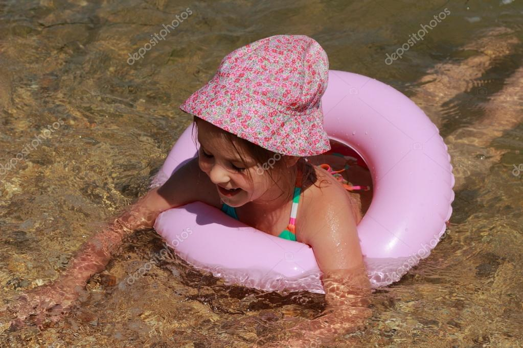 Little girl in panama swiming