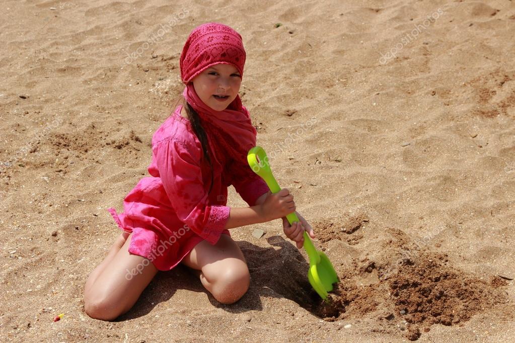 Lovely little girl over the sea