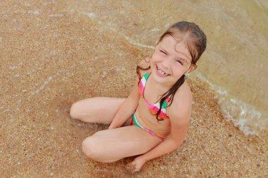 Seashell in kid hand