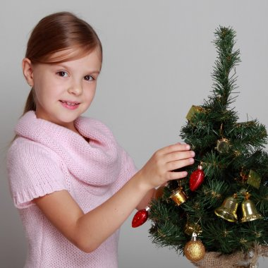 Child near a decorated Christmas tree