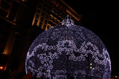 Huge Christmas decoration made of lights was placed on Manezh square in front of Kremlin