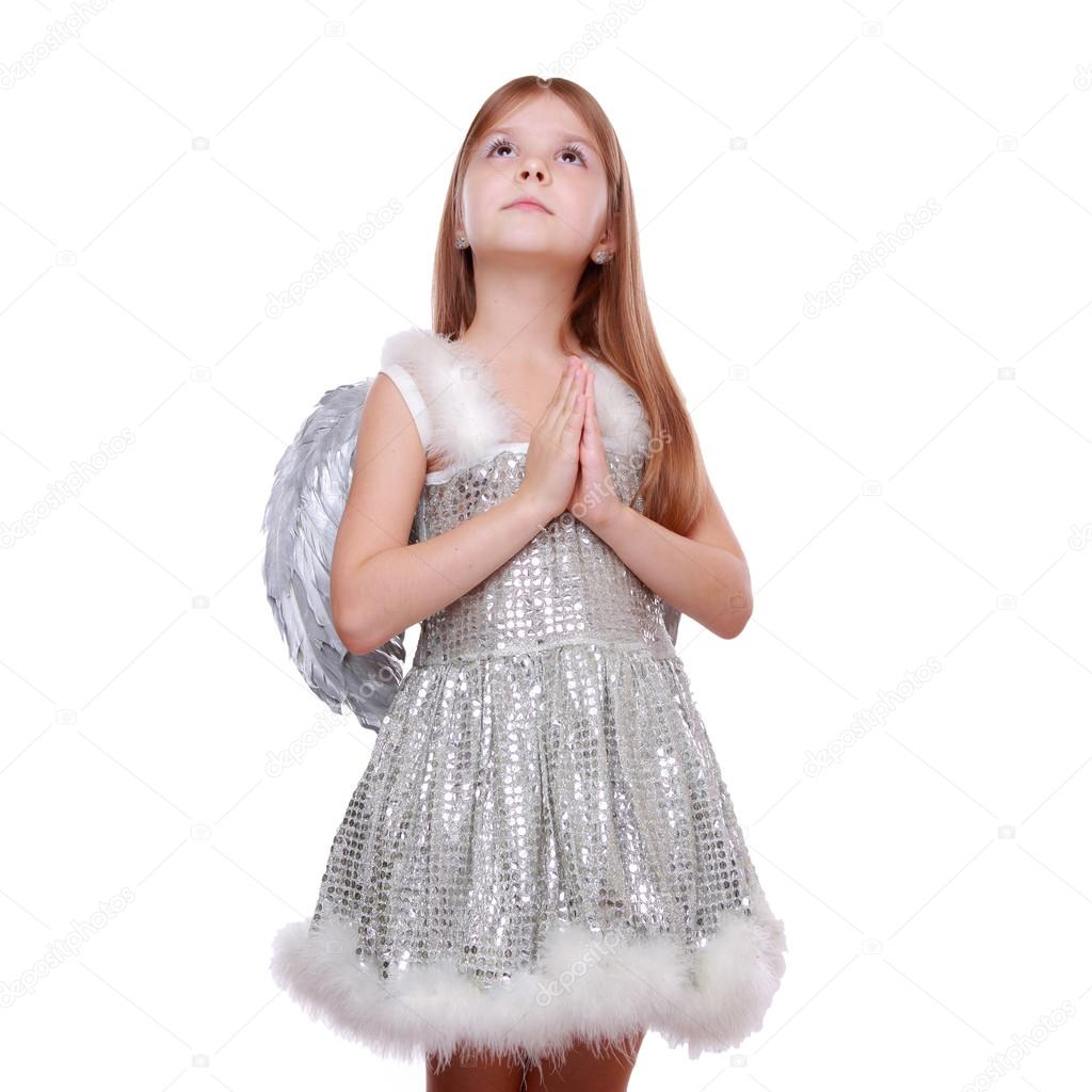 Nice portrait of cheerful lovely girl as an angel with Christmas decorative ball