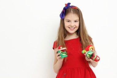Kid holding matryoshka doll