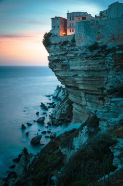 Sunset over the Old Town of Bonifacio, the limestone cliff