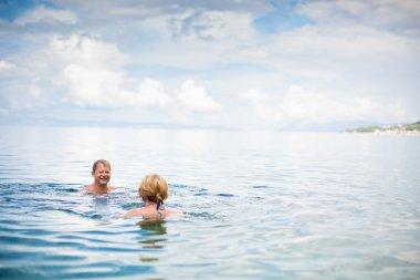 Senior couple enjoying the retirement on a seacoast