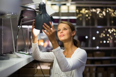 woman choosing the right lamp for her apartment