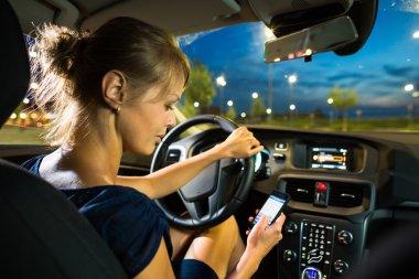Woman driving a car at night
