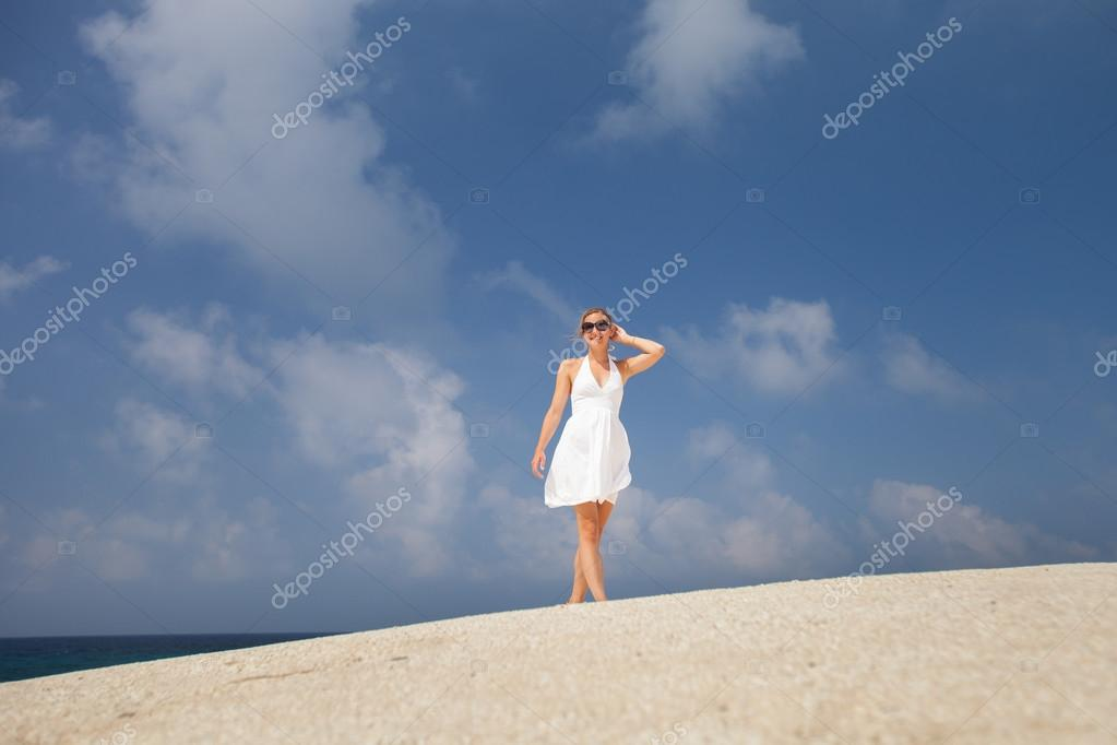 Woman outdoors, enjoying the sunlight