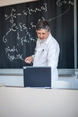 Senior chemistry professor at lecture
