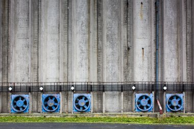 Concrete wall of a cereal silo tower with vents