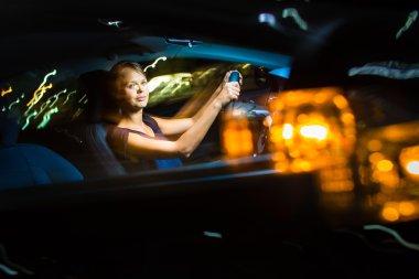 Woman driving her modern car
