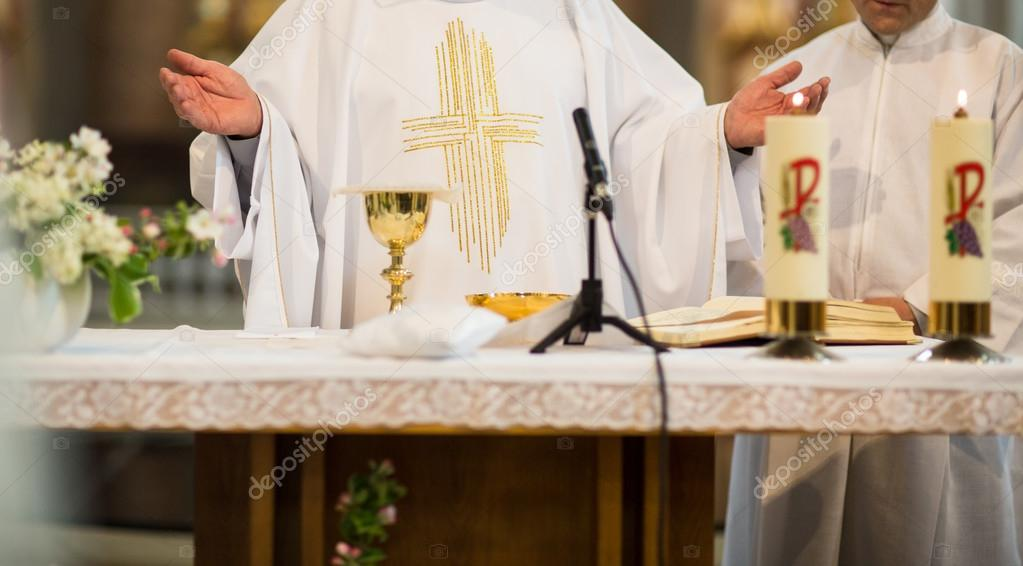 Priest during a wedding ceremony - nuptial mass