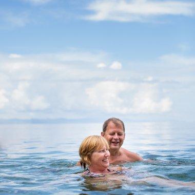Senior couple enjoying the retirement on a seacost