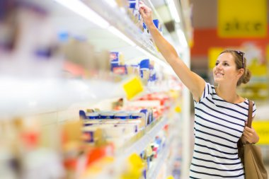 Woman shopping for diary products at a grocery