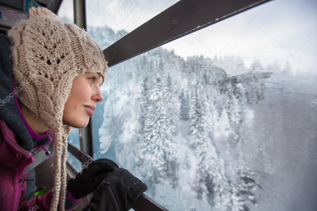 Pretty, young woman admiring splendid winter scenery