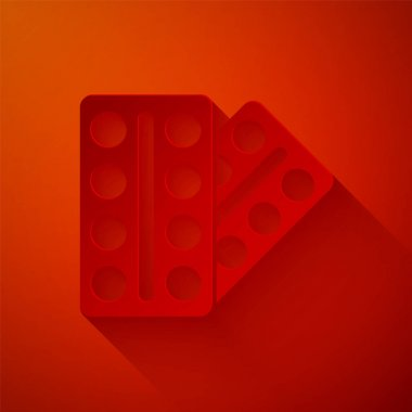 Paper cut Pills in blister pack icon isolated on red background. Medical drug package for tablet, vitamin, antibiotic, aspirin. Paper art style. Vector.. icon