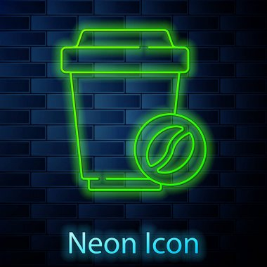 Glowing neon line Coffee cup to go icon isolated on brick wall background.  Vector. icon