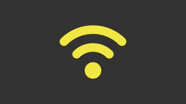 Gelbes Symbol des drahtlosen Internet-Netzwerks Wi-Fi isoliert auf grauem Hintergrund. 4K Video Motion Grafik Animation