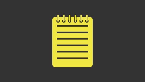 Sárga Notebook ikon elszigetelt szürke háttérrel. Spirál jegyzettömb ikon. Írócédula. Üzleti napló. Szerelmünk laptopja. 4K Videó mozgás grafikus animáció