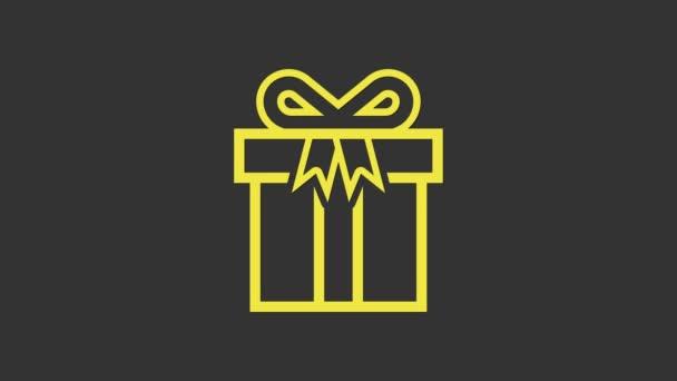 Sárga Ajándék doboz ikon elszigetelt szürke háttér. 4K Videó mozgás grafikus animáció
