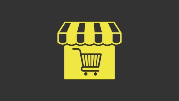 Žlutá Nákupní budova nebo obchod s ikonou nákupního košíku izolované na šedém pozadí. Výstavba obchodu. Symbol supermarketu. Grafická animace pohybu videa 4K