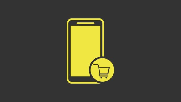 Yellow Mobile phone and shopping cart icon isolated on grey background. Online buying symbol. Supermarket basket symbol. 4K Video motion graphic animation