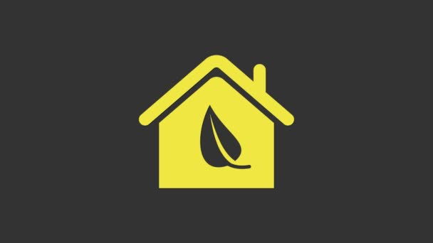 Yellow Eco friendly house icon isolated on grey background. Eco house with leaf. 4K Video motion graphic animation