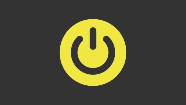 Gelbe Power-Taste Symbol isoliert auf grauem Hintergrund. Startschild. 4K Video Motion Grafik Animation