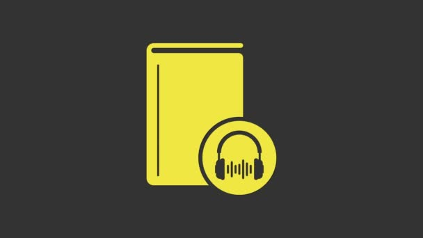 Yellow Audio book icon isolated on grey background. Book with headphones. Audio guide sign. Online learning concept. 4K Video motion graphic animation