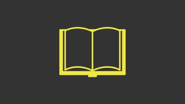 Sárga Nyílt könyv ikon elszigetelt szürke háttér. 4K Videó mozgás grafikus animáció