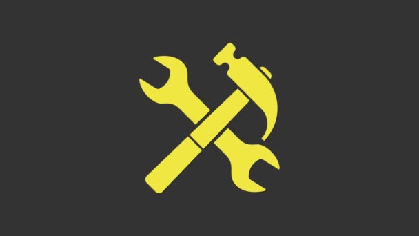 Yellow Crossed hammer and wrench icon isolated on grey background. Hardware tools. 4K Video motion graphic animation