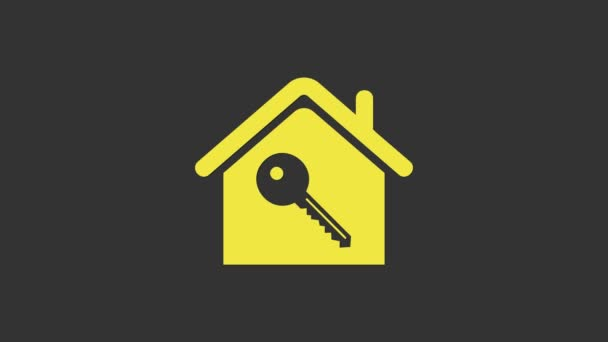 Žlutý dům s klíčovou ikonou izolované na šedém pozadí. Koncept domu na klíč. Grafická animace pohybu videa 4K