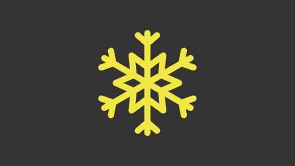 Sárga hópehely ikon elszigetelt szürke háttér. 4K Videó mozgás grafikus animáció