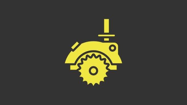 Žlutá elektrická kruhová pila s ocelovou ikonou zubu izolovanou na šedém pozadí. Elektrický ruční nástroj pro řezání dřeva nebo kovu. Grafická animace pohybu videa 4K