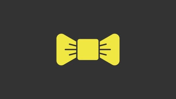 Sárga csokornyakkendő ikon elszigetelt szürke háttér. 4K Videó mozgás grafikus animáció
