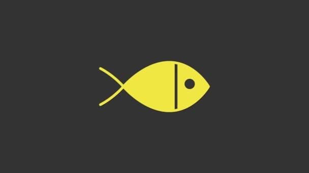 Sárga keresztény hal szimbólum ikon elszigetelt szürke háttér. Jézus hal szimbólum. 4K Videó mozgás grafikus animáció