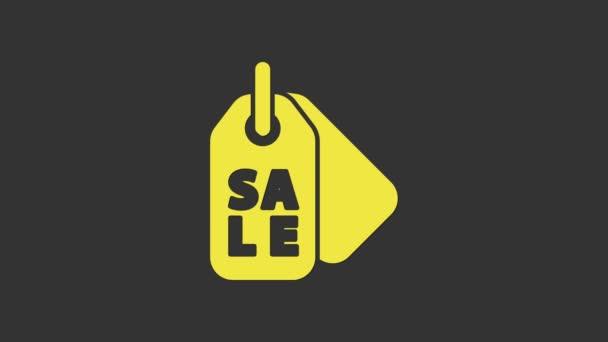 Sárga árcédula felirattal Eladó ikon elszigetelt szürke alapon. A jelvény ára. Promo tag kedvezmény. 4K Videó mozgás grafikus animáció