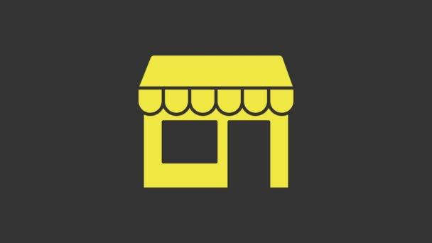 Žlutá Nákupní budova nebo ikona obchodu izolované na šedém pozadí. Výstavba obchodu. Grafická animace pohybu videa 4K